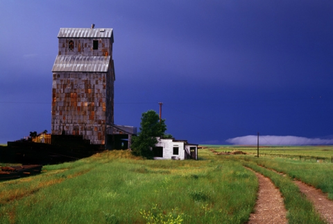 "Wooden grain elevator at Collins, Montana entitled ""After the Storm"""
