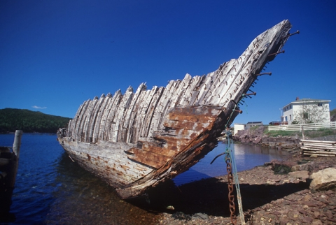 "Photograph of wooden hull entitled ""Grounded"""