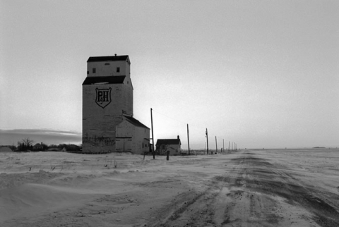 "P&H Wooden grain elevator at Lewvan, Saskatchewan, ""First Light in February"""