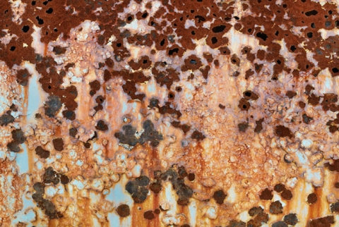 "Image of rust and  loose paint entitled ""Empty Future"""