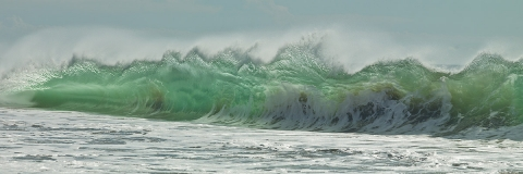 Ocean waves, seascapes, sandy beaches, blues and greens , foam and wave spray,  rolling waves, see through waves.