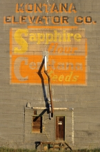 Logo on wooden grain elevator at Sipple, Montana