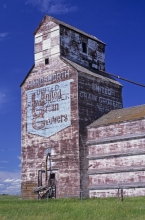 Logo on wooden grain elevator at Handsworth, Saskatchewan