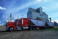 Grain truck with wooden grain elevator at Grande Prairie, Alberta